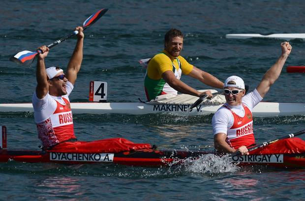 This file photo taken on August 11, 2012 shows Russia's Yury Postrigay (R) and Alexander Dyachenko celebrating after winning the gold medal in the kayak double (K2) 200m men's final A during the London 2012 Olympic Games, at Eton Dorney Rowing Centre in Eton, west of London. Canoeing's governing body has banned five Russians, including a gold medallist and a five-times world champion, from next month's Rio Olympics after an explosive independent report revealed state-run doping across Russian sport.