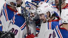 New York Rangers goalie Henrik Lundqvist is congratulated by teammate Daniel Carcillo (Ryan Remiorz/The Canadian Press)