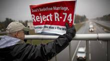 On an overpass near Seattle, Wash., on Oct. 30, 2012, 'Norsky,' an advocate against gay marriage, implores drivers to vote no on Referendum 74, which asks voters to endorse or reject a state law legalizing same-sex marriages that has been passed but not implemented. (John Lehmann/The Globe and Mail)