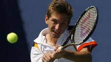 Filip Peliwo of Canada returns to Liam Broady of Britain during their junior boy's singles finals match at the U.S. Open tennis tournament in New York September 9, 2012. (EDUARDO MUNOZ/REUTERS)