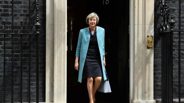 This file photo taken on June 27, 2016 shows British Home Secretary Theresa May walking through the door of 10 Downing Street after attending a cabinet meeting.