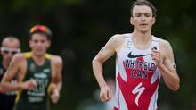 Canadian Simon Whitfield, right, runs on his way to a sixth place finish at the ITU Men's Elite Triathlon World Cup event held at William Hawrelak Park, Edmonton, Alberta, on July 10, 2011. (John Ulan/THE CANADIAN PRESS)