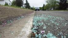 Broken glass remains on a residential street in Moncton, New Brunswick, where an RCMP constable was shot dead. Justin Bourque, taken in a manhunt after shooting five RCMP officers is charged with first degree murder in the deaths three RCMP officers. (FERD LUM/THE GLOBE AND MAIL)