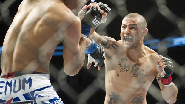Cub Swanson, right, throws the knock out punch to Charles Oliveira during the featherweight bout at UFC 152 in Toronto on Saturday, Sept. 22, 2012. (Nathan Denette/THE CANADIAN PRESS)