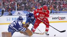 Detroit Red Wings left wing Henrik Zetterberg (40) tries to settle the puck for a shot against Toronto Maple Leafs goalie Jonathan Bernier (45) in the second period during the 2014 Winter Classic hockey game at Michigan Stadium. (Rick Osentoski/USA Today Sports)