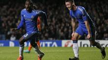 Chelsea's Victor Moses (L) celebrates with teammate Gary Cahill after scoring a goal during their Champions League Group E soccer match against Shakhtar Donetsk at Stamford Bridge in London November 7, 2012. (STEFAN WERMUTH/REUTERS)