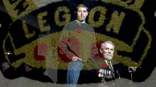 Canadian war veterans, Mat Belear, left, and Gus MacGillivary are reflected in a banner at the Legion in Amherstview near Kingston, Ont. Nov. 3/2011. (Kevin Van Paassen/The Globe and Mail/Kevin Van Paassen/The Globe and Mail)
