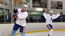 Edmonton Oilers defenceman Ladislav Smid, left, and forward Eric Belanger celebrate a goal during the Oilers first practice after the NHL lockout, in Edmonton, Alta., on Monday January 7, 2013. (JASON FRANSON/THE CANADIAN PRESS)