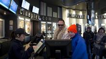 Customers purchase movie tickets at the Cineplex Scotiabank Theatre in Toronto in this file photo. (Matthew Sherwood For The Globe and Mail)