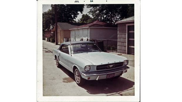 Gail Wise's 1965 Ford Mustang Convertible in summer 1964. She is thought to be the first person to buy a Mustang. (Ford)