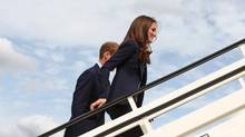Kate boards the plane that brought her to Canada, wearing a blazer made by Canadian designer Smythe. (Steve Parsons/AFP/Getty Images)