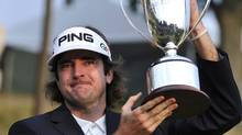 Bubba Watson holds up the championship trophy at the Travelers Championship golf tournament on Sunday, June 27, 2010, in Cromwell, Conn. Watson won for the first time on the PGA Tour, coming from six shots down to win the Travelers Championship in a three-way playoff. (AP Photo/Jessica Hill) (Jessica Hill/AP2010)