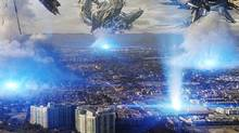 "In this film publicity image released by Universal Pictures, alien ships attack the city of Los Angeles in the sci-fi thriller, ""Skyline"". (Photo Credit: [hy*drau""lx]/Rogue/AP Photo/Universal Pictures)"