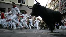 The running of the bulls at the San Fermin festival in Pamplona, Spain, July 13, 2009. (VINCENT WEST/REUTERS)