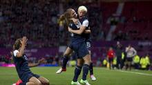 United States' Megan Rapinoe, right, celebrates with teammate Alex Morgan after scoring against Canada during their semifinal women's soccer match at the 2012 London Summer Olympics, Monday, at Old Trafford Stadium in Manchester, England. (Jon Super/AP)