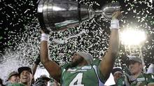 Saskatchewan Roughriders quarterback Darian Durant hoists the cup after beating the Hamilton Tiger-Cats in the Grey Cup, Sunday, Nov. 24, 2013 in Regina. (Frank Gunn/The Canadian Press)