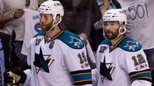 San Jose Sharks' Joe Thornton, left, and Patrick Marleau leave the bench after losing 7-3 to the Vancouver Canucks in Game 2 of the NHL Western Conference Final Stanley Cup playoff hockey series in Vancouver, B.C., on Wednesday May 18, 2011. (The Canadian Press)
