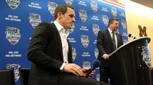 Toronto Maple Leafs defenseman Dion Phaneuf listens as general manager Dave Nonis answers questions (Jerry Lai/USA Today Sports)