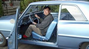 Charles Tan, 44 years later, in the restored Chevy II.