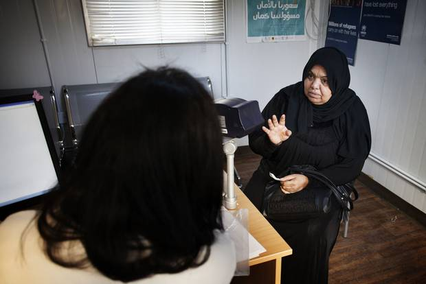 60-year-old Fatima sits in the interviewing room at the UNHCR registration office in Amman. She made the list UNHCR is recommending to Canada along with her 18-year-son who currently works in a blinds factory and hopes to continue hie education.