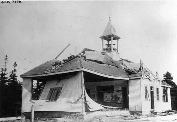 A view of the post-explosion aftermath at Tufts' Cove School House, at the northeast corner of Albro Lake Road and the road to Tufts' Cove, just north of Dartmouth.