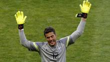Brazil's goalkeeper Julio Cesar celebrates after winning their 2014 World Cup round of 16 game against Chile at the Mineirao stadium in Belo Horizonte June 28, 2014. (Reuters)