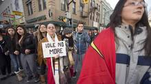 Protesters from the Idle No More movement dance in a drum circle in downtown London, Ont., Jan. 10, 2013. (Geoff Robins/The Canadian Press)