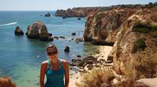 Natalie Stechyson hikes the cliffs that weave behind the beaches in Lagos, Portugal. (Lauren Sally for The Globe and Mail)