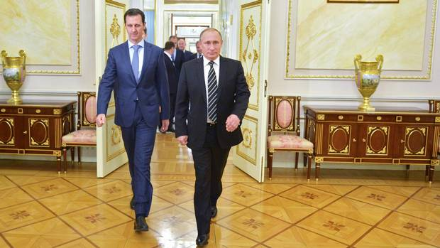 Russian President Vladimir Putin, right, and Syrian President Bashar al-Assad. Justin Trudeau inherits a government that has put some noses out of joint with pugnacious pro-Israel and pro-Ukraine stances under Stephen Harper.