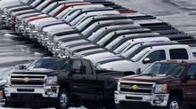 Chevy trucks line the lot of a dealer in Murrysville, Pa. in a file photo. Ford, Chrysler and General Motors all reported double-digit gains for January as last year's momentum in U.S. auto sales continued into 2013. (Gene J. Puskar/AP)