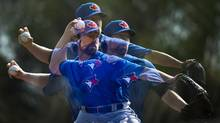 Toronto Blue Jays pitcher R.A. Dickey revived his career with the knuckleball, winning the Cy Young and a big new contract. (Nathan Denette/THE CANADIAN PRESS)