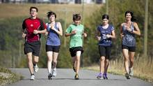 The Savoie family run a trail near their home in Calgary. (Chris Bolin For The Globe and Mail)