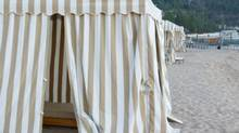 Beach-side stripped cabana. (Thinkstock)