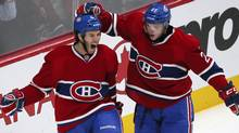 Montreal Canadiens' Brandon Prust, left, celebrates his goal with teammate Alex Galchenyuk (27) during third period NHL hockey action against Carolina Hurricanes in Montreal, February 18, 2013. (Reuters)