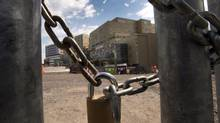 A padlock chains the fence at the MUHC super hospital as a province wide strike shuts down work sites in Montreal on June 18, 2013. The Quebec government is planning to introduce back-to-work legislation to bring an end to the province's construction strike. (Ryan Remiorz/THE CANADIAN PRESS)