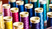 Threads produced by British company Coats hold together one in five garments on the planet. (Jupiterimages/Getty Images)
