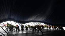 "Some 60 workers raise a section of the Cirque du Soleil ""Big Top"" at Marymoor Park in Redmond, Wash. in 2013. (Greg Gilbert/(File) AP/The Seattle Times)"