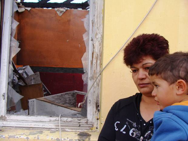 2010: Csabane Csorba and her three-year-old grandson, Mate, examine the ruins of their house in the Hungarian Roma village of Tatarszentgyorgy. Her son Robert, 27, Mate's father, and his other son Robert Jr., 5, were killed in a firebomb and gunfire attack by a far-right militia. Similar attacks over the years have sent a flood of Roma refugees to Canada to seek asylum from growing extremism.