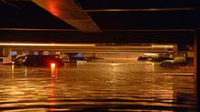Vehicles are inundated in several feet of water in a parking structure on the UCLA campus after flooding from a broken 30-inch water main under nearby Sunset Boulevard inundated a large area of the campus in the Westwood section of Los Angeles, Tuesday, July 29, 2014. (Mike Meadows/AP)