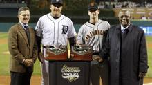 Detroit Tigers third baseman Miguel Cabrera (2nd from L) and San Francisco Giants catcher Buster Posey (2nd from R) are flanked by Tim Brosnan, Executive Vice President, Business, for Major League Baseball, and Hall of Famer Hank Aaron (R), during a ceremony presenting them with their Hank Aaron Awards prior to Game 3 of the MLB World Series baseball championship between the Giants and the Tigers in Detroit, Michigan, October 27, 2012. (MARK BLINCH/REUTERS)