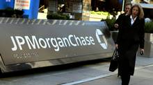 Pedestrians walk past the JP Morgan Chase headquarters in New York. (DON EMMERT/AFP/Getty Images)