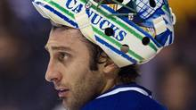 Goalie Roberto Luongo and the Vancouver Canucks face the Washington Capitals on Saturday night. (Photo by Rich Lam/Getty Images) (Rich Lam/Getty Images)