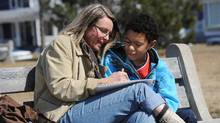 Krista Steeves sketches on a bench in Wilmot Park in Fredericton with her son Blair Steeves, 11, on April 17, 2011. (Globe and Mail)