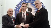 Hockey Hall of Fame inductee Chris Chelios smiles after being presented with his ring at the Hall in Toronto on Friday November 8, 2013. (REUTERS)