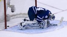 Toronto Maple Leafs goalie James Reimer slumps to the ice as the Sharks score a third goal during the second period of NHL play between the Toronto Maple Leafs and the San Jose Sharks in Toronto. (Deborah Baic/The Globe and Mail)