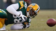 Green Bay Packers tight end Jermichael Finley drops a pass under New York Giants safety Antrel Rolle (26) during the first the first half of an NFL divisional playoff football game Sunday, Jan. 15, 2012, in Green Bay, Wis. (AP Photo/Jeffrey Phelps) (Jeffrey Phelps/AP)