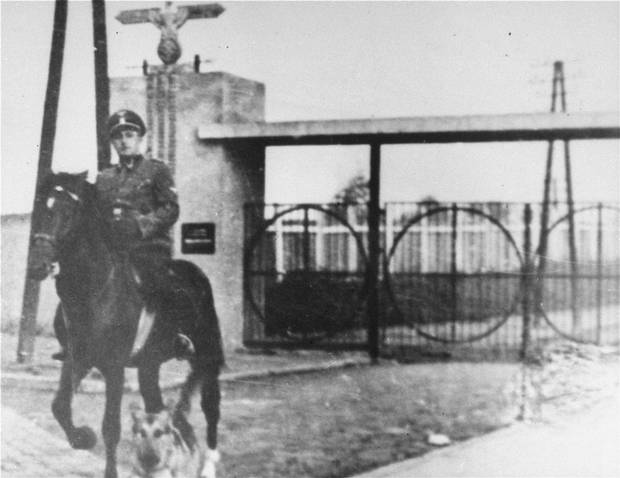 An undated photo shows SS officer Gustav Willhaus at the gate of the Janowska concentration camp in Nazi-occupied Poland. Dr. Feinman recalls that Mr. Willhaus, the camp commandant, told the prisoners that they would all perish.
