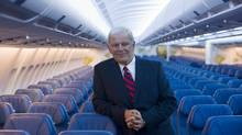 Air Transat CEO and president Allen Graham poses for a photograph aboard an Airbus A330 during the unveiling of the new interior design of Transat jets in Montreal, Thursday, May 17, 2012. (Graham Hughes/THE CANADIAN PRESS)