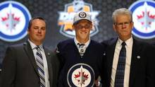 Nikolaj Ehlers poses for a photo with team officials after being selected as the number nine overall pick to the Winnipeg Jets in the first round of the 2014 NHL Draft at Wells Fargo Center. (Bill Streicher/USA Today Sports)
