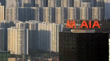 AIG has a one-third stake in Asian insurance company AIA. (DANIEL SORABJI/AFP/Getty Images)